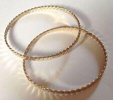 2 bracelets vintage rigide de couleur or finement travaillé 3299
