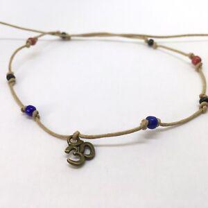 Tie on bronze OM AUM & blue red black beads bracelet india karmastring 45cm+
