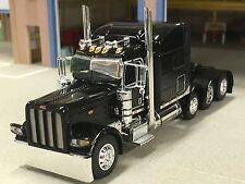 """1/64 DCP BLACK 389 PETERBILT TRI-AXLE W/ 70"""" SLEEPER"""