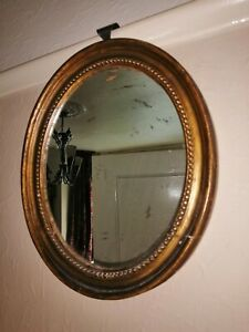 Small Oval Antique / Regency Style Oval Gilt Mirror.
