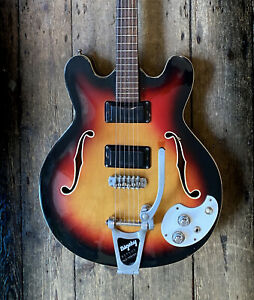 1960's MOSRITE CELEBRITY WITH BIGSBY IN SUNBURST AND HARD SHELL CASE