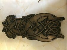 Celtic wall plaque in bronze. Animals from the book of Kells. Celtic crafts.