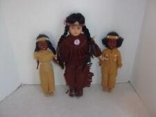 ASHLEY BELLE COLLECTION PORCELAIN  INDIAN GIRL DOLL. + (2) other dolls