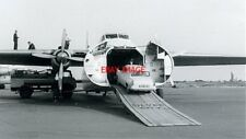 PHOTO  LOADING A FORD ANGLIA 1960