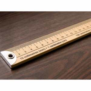 Wooden metre rule stick: Metric and imperial. Brass ends.