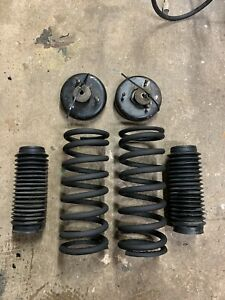 LOTUS ELAN M100 1989-1995 FRONT SUSPENSION SPRINGS, TOP MOUNTS AND SHOCK COVERS