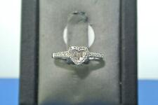 Women's 14k white gold heart set baguette and round diamond engagement ring
