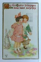 1917 Tuck Easter Boy & Girl Collecting Eggs Rabbit Oilette Vintage Postcard