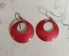 Round Red Earrings With An Off-Center Hole
