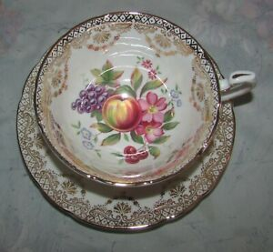 Vintage Paragon Tea cup and Saucer Gold trim with Fruit pattern
