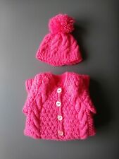 Hand Knitted All In One coat and hat for newborn in lipstick pink.