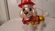 """POODLE DOG CHRISTMAS ORNAMENT DRESSED AS A FIRE FIGHTER, 4 1/2""""  X   5 1/2""""GLASS"""