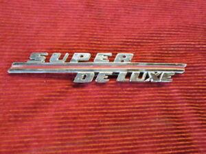 VINTAGE 1946 NOS FORD SUPER DELUXE EMBLEM. ORIGINAL FORD NOS EMBLEM