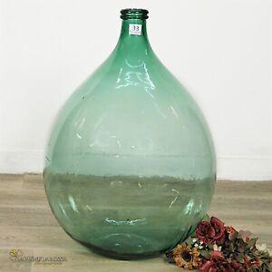 Damigiana in vetro da 54 litri antica vecchio boccione verde per vino giardino .