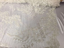 Fantastic heavy beaded bridal wedding mesh lace fabric ivory. Sold by yard.