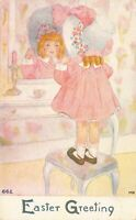 Easter Postcard Little Girl Putting on Her Bonnet~127255