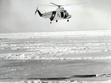 1977 Original Photo USCG Helicopter Crew hovers over oil slick from barge wreck