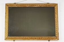 A late 18th - early 19th century carved mirror.