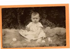 Real Photo Postcard RPPC - Baby and Rattle on Animal Skin Outdoors