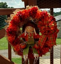 Fall is on its way, be ready with this burlap scarecrow wreath.