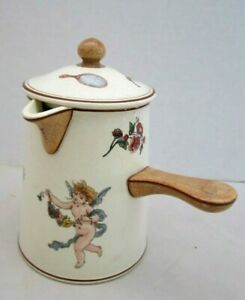 "Vintage Pitcher Creamer w/Handle & Lid. Cupids Angels Flowers Ceramic. 6"" tall."