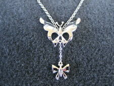 Butterfly and bow necklace