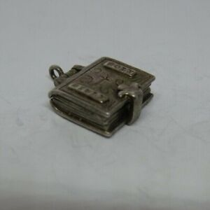 Vintage silver holy bible charm, opens to reveal pages of the bible, nuvo