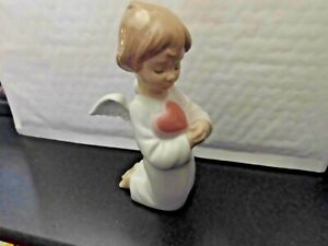 "NAO C15 - 2 JUN 2011  ANGEL WITH PINK HEART UNBOXED 6.5"" TALL UNBOXED AS SHOWN"