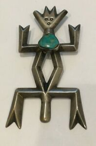 NATIVE AMERICAN VINTAGE DANCING MAN PENDANT WITH TURQUOISE STONE