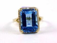 14k Yellow Gold Emerald-cut Blue Topaz and Diamond Ring