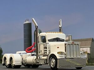 1/64 DCP WHITE PETERBILT 389 DAY CAB