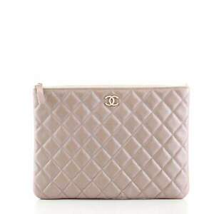 Chanel O Case Clutch Quilted Iridescent Caviar Medium