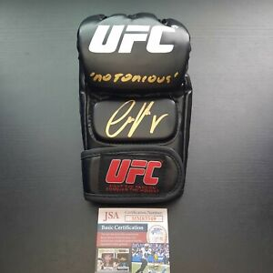 """Conor McGregor Signed Autographed UFC MMA Glove with """"Notorious"""" inscription JSA"""