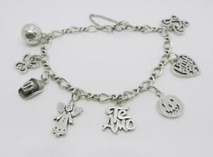 JAMES AVERY STERLING SILVER CHARM BRACELET WITH 8 CHARMS - LB-C1148