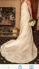 Pre-loved stunning wedding dress. lvory satin with intricate beading.