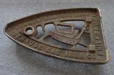 3 leg cast iron trivet advertising Strause Gas Iron Co