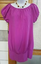 BEBE DESIGNER DRESS SIZE LARGE PURPLE DRESS. NEW WITH TAG $129.00
