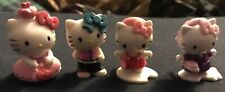 4 Vintage Hello Kitty 1976-2010 Collectable figurines by Sanrio.co.LTD