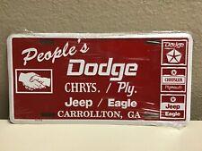 NOS Dealer License Plate PEOPLE'S DODGE CHRYSLER PLYMOUTH JEEP EAGLE Pentastar