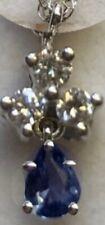 14kt white gold pendant  .15 diamonds and .21 yogo sapphire .32tcw