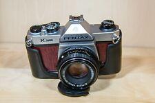 PENTAX K1000 Film Camera w/ 50mm f/2 Pentax-M Lens. Near-MINT. New Light Seals.