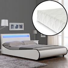 Corium® Cama moderna  tapizada LED + colchón 140x200 cm, cuero sintético, blanca