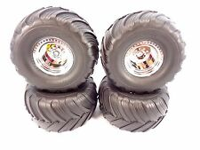 NEW TRAXXAS SET OF STAMPEDE BIGFOOT CHROME 12mm WHEELS & TIRES SKULLY CRANIAC