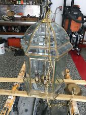 Gold, glass (acrylic) 6 light chandelier with hanging chain in good condition.