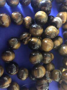 Tiger's Eye Round 11mm beads. 30 beads per strand. Jewellery making