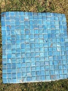 Light blue Bisazza mosaic tiles bathroom with copper accent