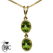 Ovale Echtschmuck-Halsketten & -Anhänger aus Gelbgold mit Peridot