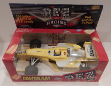 PEZ RACING CAR CANDY DISPENSER YELLOW NEW IN BOX