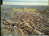 VINTAGE PHOTO POST CARD AERIAL VIEW FROM THE HEART OF SPOKANE WASHINGTON.