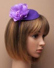 Small purple oval satin pillbox with flower fascinator headband
